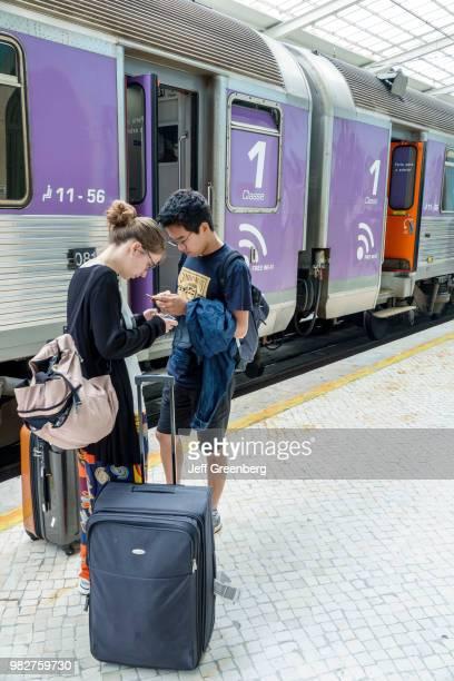 Portugal Lisbon Cais do Sode railway station platform with passengers