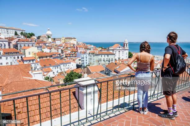 Portugal Lisbon Miradouro das Portas do Sol couple on observation deck looking at view