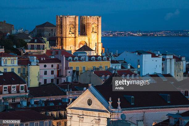 Night view of Santa Maria Maior Cathedral's steeples Lisbon's cathedral is the oldest church in the city In the background the Tagus river 2012