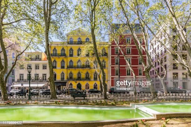 portugal, lisbon, old buildings at avenida da liberdade - avenida fotografías e imágenes de stock