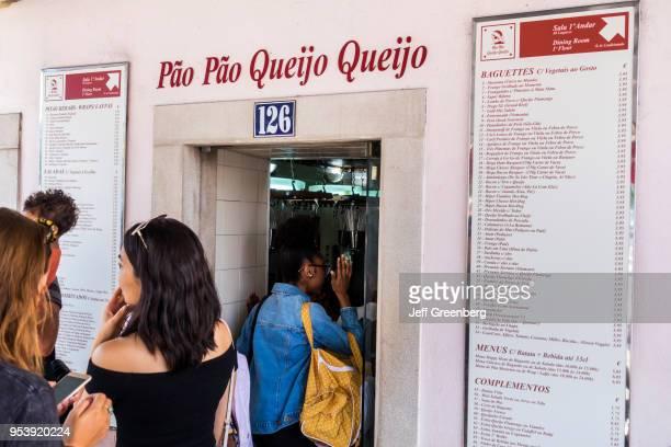 Portugal Lisbon Rua de Belem Pao Pao Queijo Queijo order line at sandwich shop