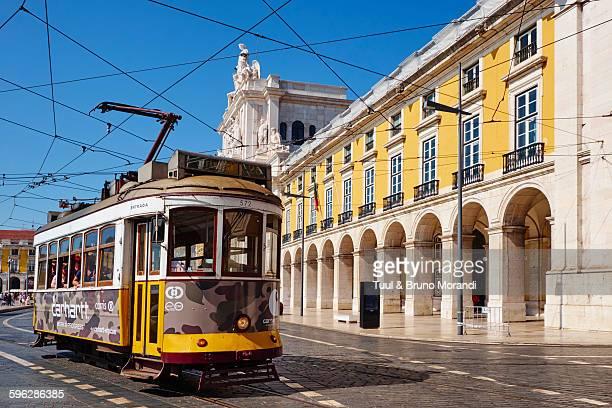 portugal, lisbon, tram at commerce square - praça do comércio imagens e fotografias de stock