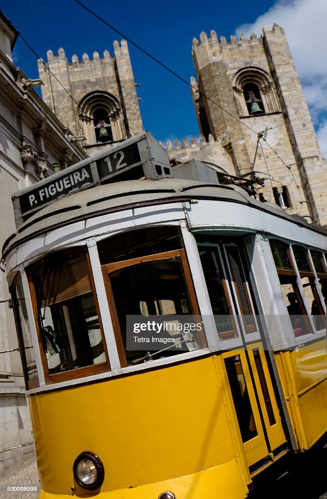 Portugal, Lisbon, Tram in front of Lisbon Cathedral : Stock Photo