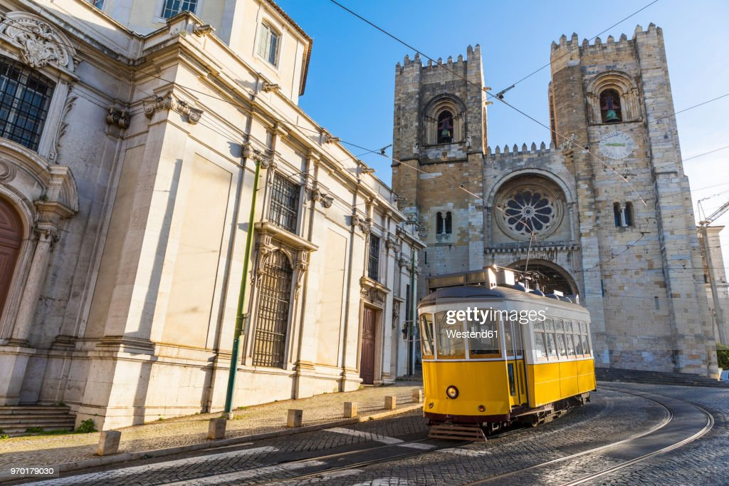 Portugal, Lisbon, typical yellow tram in front of the Cathedral : Stock Photo