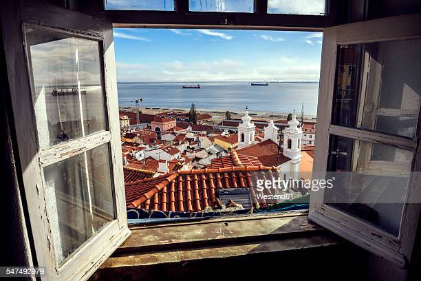 Portugal, Lisbon, view of Alfama neighborhood and River Tejo through open window