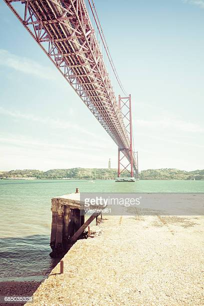 Portugal, Lissbon, Ponte 25 de Abril, Tagus river and Christo Rei statue in background