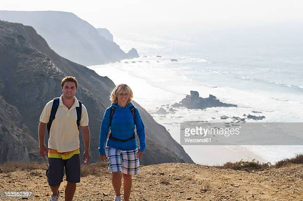 portugal, man and woman hiking on mountain - algarve stock pictures, royalty-free photos & images