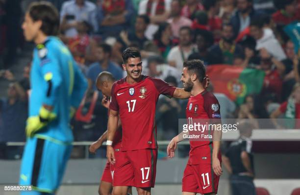 Portugal midfielder Andre Silva celebrates with team mate Portugal midfielder Bernardo Silva after scoring a goal during the FIFA 2018 World Cup...