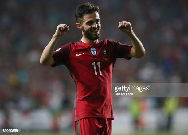 Portugal midfielder Bernardo Silva celebrates the victory at the end of the FIFA 2018 World Cup Qualifier match between Portugal and Switzerland at...