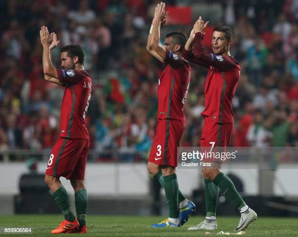Portugal midfielder Cristiano Ronaldo and teammates celebrate the victory at the end of the FIFA 2018 World Cup Qualifier match between Portugal and...