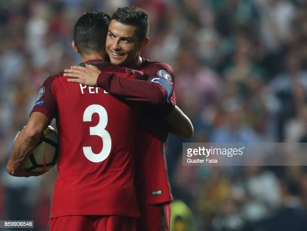 Portugal midfielder Cristiano Ronaldo celebrates with teammate Portugal defender Pepe the victory at the end of the FIFA 2018 World Cup Qualifier...