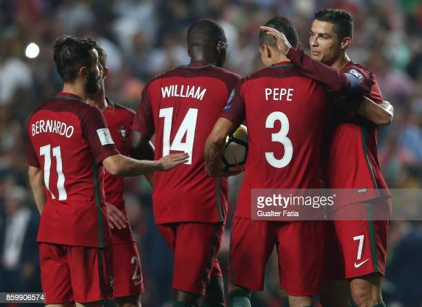 Portugal midfielder Cristiano Ronaldo celebrates with teammates the victory at the end of the FIFA 2018 World Cup Qualifier match between Portugal...