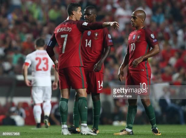 Portugal midfielder Cristiano Ronaldo talks to teammates Portugal midfielder Joao Mario and Portugal midfielder William Carvalho during the FIFA 2018...