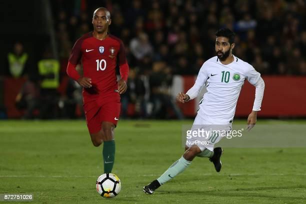 Portugal midfielder Joao Mario and Saudi Arabia forward Hazzaa Al Hazzaa during the match between Portugal v Saudi Arabia International Friendly at...