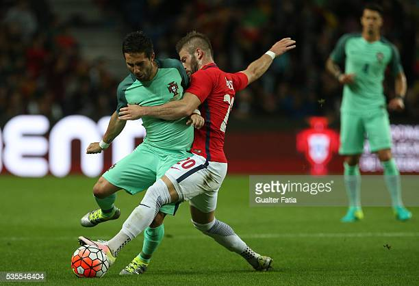Portugal midfielder Joao Moutinho tackled by Norway midfielder Valon Berisha during the International Friendly match between Portugal and Norway at...