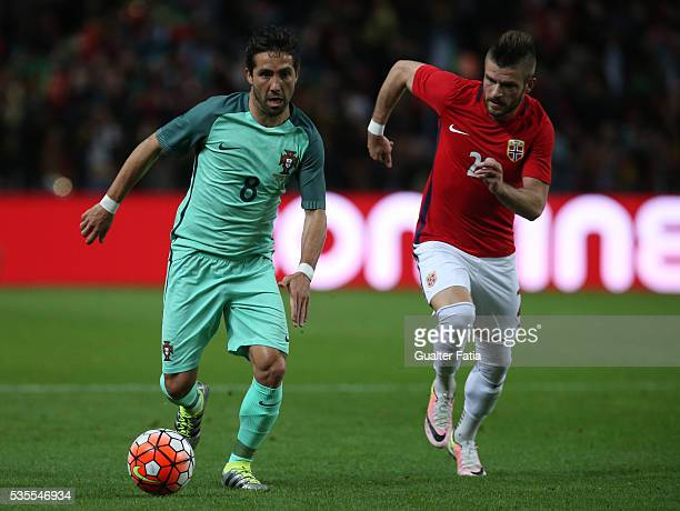 Portugal midfielder Joao Moutinho with Norway midfielder Valon Berisha in action during the International Friendly match between Portugal and Norway...