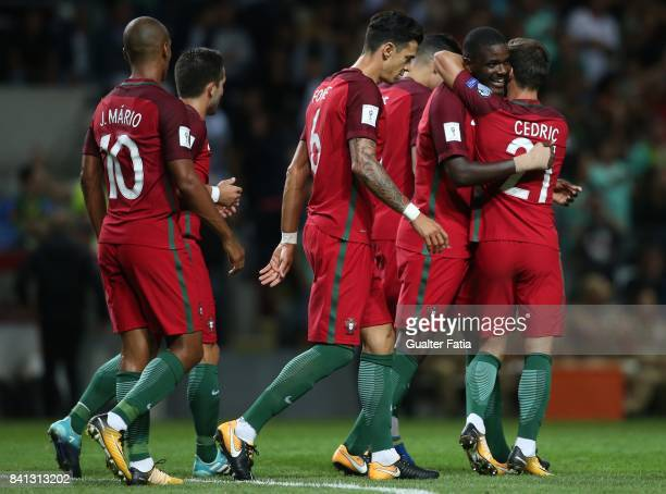 Portugal midfielder William Carvalho celebrates with teammates after scoring a goal during the FIFA 2018 World Cup Qualifier match between Portugal...