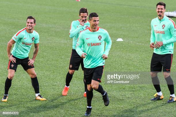 Portugal national football team forward Cristiano Ronaldo and teammates take part in a training session at the Municipal stadium in Andorra la Vella...