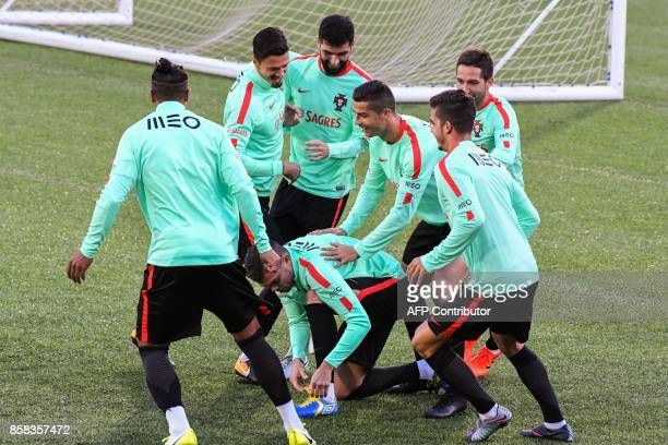 Portugal national football team forward Cristiano Ronaldo defender Pepe and teammates joke during a training session at the Municipal stadium in...