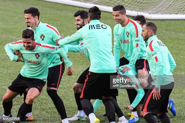 Portugal national football team forward Cristiano Ronaldo midfielder Ricardo Quaresma forward Andre Silva and teammates take part in a training...