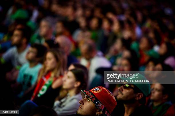 Portugal national football team's supporters watch on a screen at Alameda square the Euro 2016 group football match between Portugal and Croatia in...