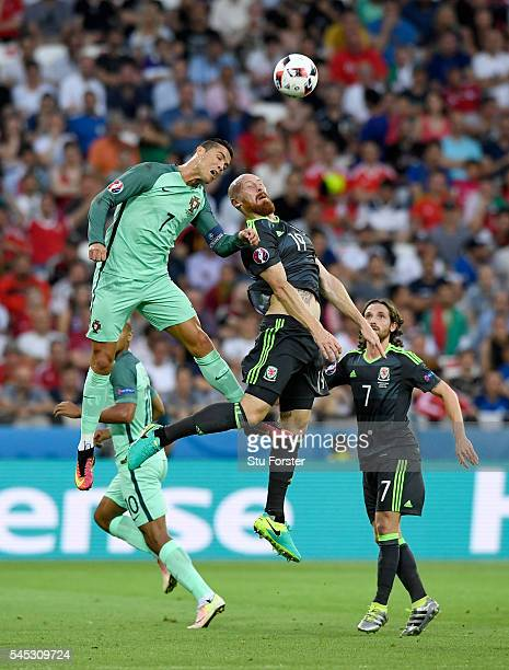Portugal player Cristiano Ronaldo is challenged by James Collins of Wales during the UEFA EURO 2016 semi final between Wales and Portugal at Stade...