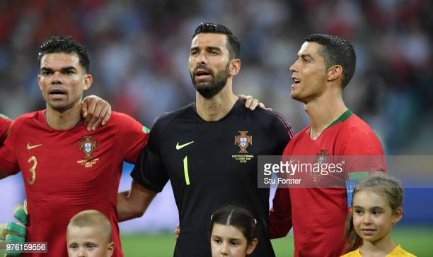 Portugal player Cristiano Ronaldo looks on during the singing of the national anthem with Pepe and Rui Patricio during the 2018 FIFA World Cup Russia...