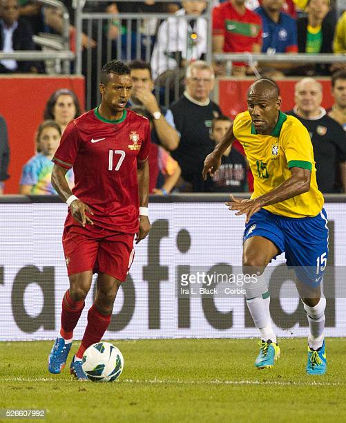 Portugal player Nani drives forward against Brazil player Maicon during the Gillette Brazil Global Tour match between Brazil and Portugal Brazil won...
