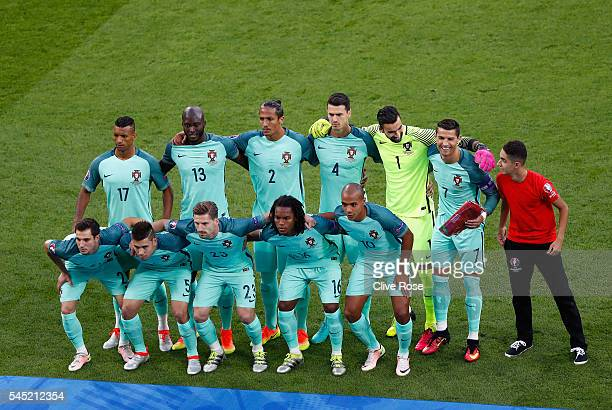 Portugal players and a ball boy line up prior to the UEFA EURO 2016 semi final match between Portugal and Wales at Stade des Lumieres on July 6 2016...
