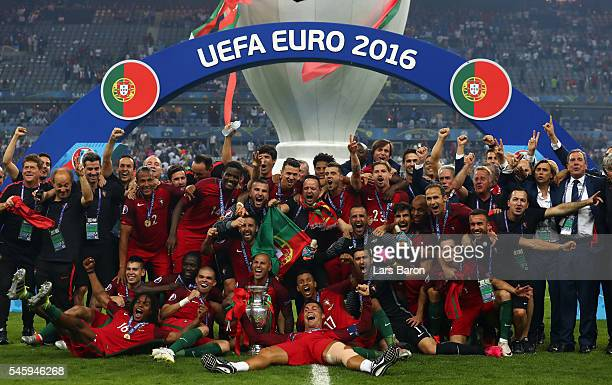 Portugal players and staffs celebrate after their 1-0 win against France in the UEFA EURO 2016 Final match between Portugal and France at Stade de...