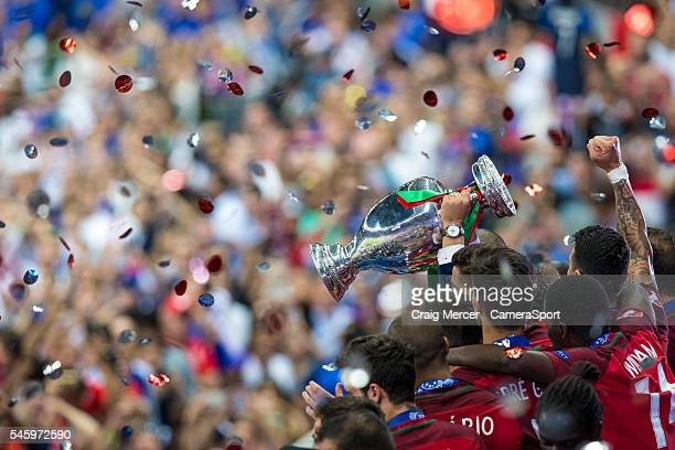 Portugal players celebrate by lifting the winners trophy during the UEFA Euro 2016 Final match between Portugal and France at Stade de Lyon on July...