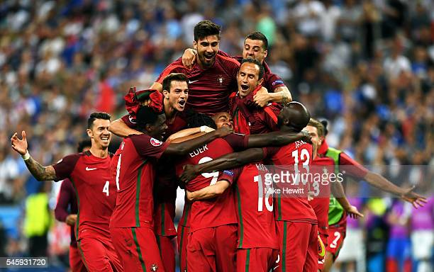 Portugal players celebrate winning after the UEFA EURO 2016 Final match between Portugal and France at Stade de France on July 10, 2016 in Paris,...