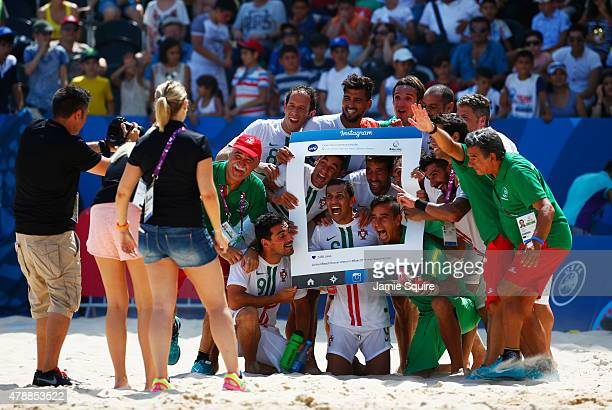 Portugal players celebrate winning bronze after the Men's Beach Soccer bronze medal match between Switzerland and Portugal on day sixteen of the Baku...