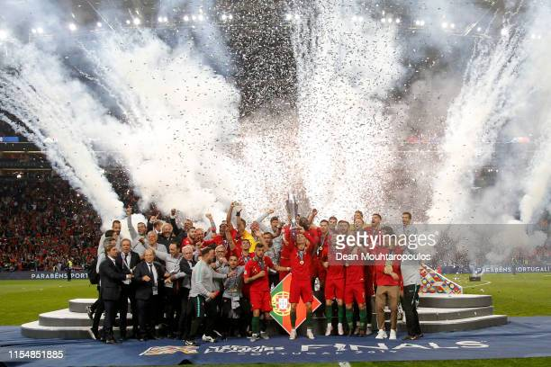 Portugal players celebrate with the UEFA Nations League Trophy following their victory in the UEFA Nations League Final between Portugal and the...