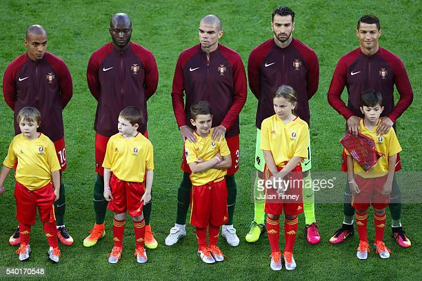 Portugal players line up for the national anthem priro to the UEFA EURO 2016 Group F match between Portugal and Iceland at Stade GeoffroyGuichard on...