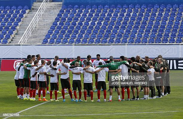 Portugal players observe a minute of silence in honour of refugees and migrants coming to Europe prior to their training session at Coimbra da Mota...