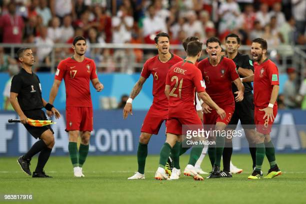 Portugal players react after Cedric receives a yellow card from Referee Enrique Caceres the 2018 FIFA World Cup Russia group B match between Iran and...