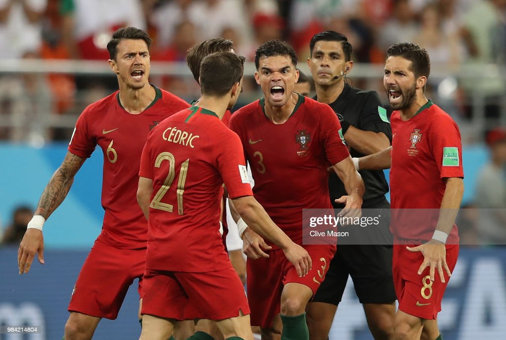 Portugal players react and Cedric receives a yellow card from Referee Enrique Caceres during the 2018 FIFA World Cup Russia group B match between Iran and Portugal at Mordovia Arena on June 25, 2018 in Saransk, Russia.