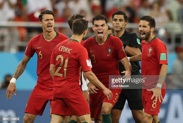 Portugal players react and Cedric receives a yellow card from Referee Enrique Caceres during the 2018 FIFA World Cup Russia group B match between...
