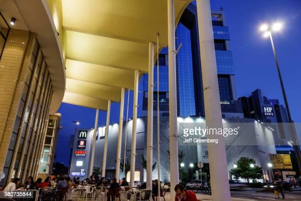 Portugal, Porto, Mercado do Bom Sucesso, alfresco dining at night.