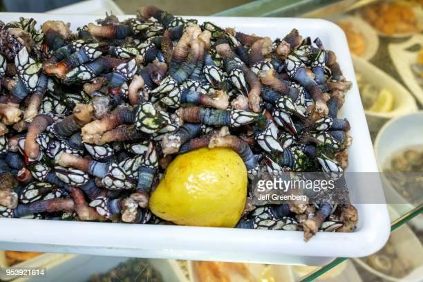 Portugal, Porto, Mercado do Bom Sucesso, plate of edible Goose Barnacles.