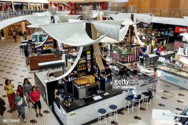 Portugal, Porto, Mercado do Bom Sucesso, urban market with food vendors.