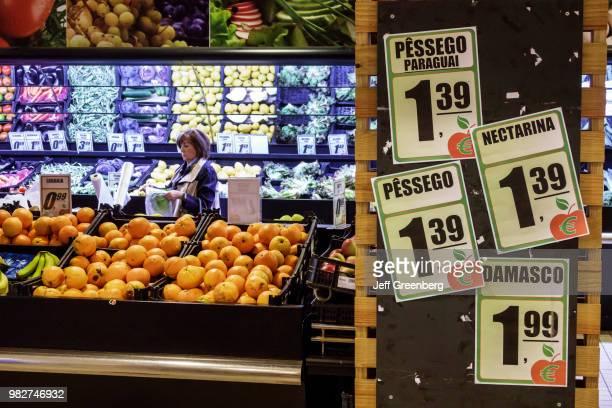 Portugal, Porto, Mercado do Bom Sucesso, urban market with fruit vendors.