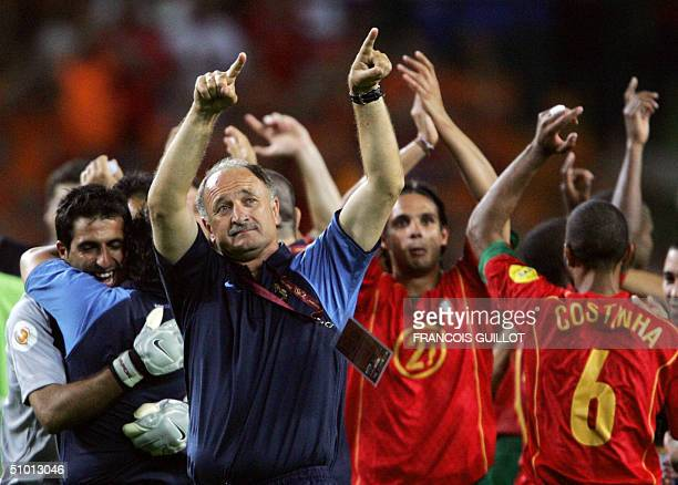 Portugal's Brazilian head coach Luiz Felipe Scolari celebrates with his players 30 June 2004 at the Alvalade stadium in Lisbon at the end of the Euro...