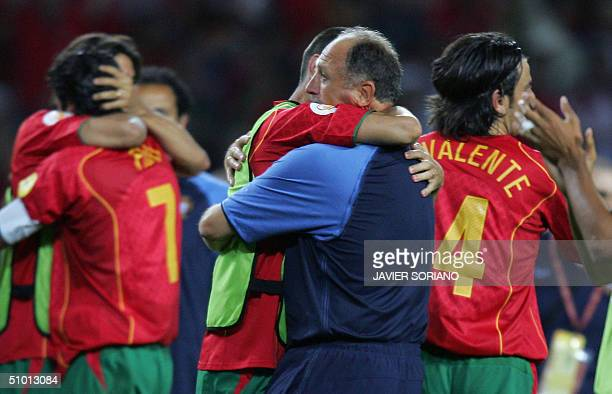 Portugal's Brazilian head coach Luiz Felipe Scolari celebrates with his players, 30 June 2004 at the Alvalade stadium in Lisbon, at the end of the...