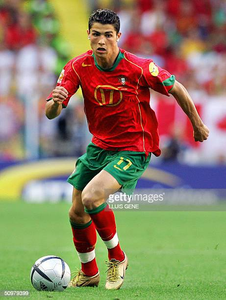 Portugal's forward Cristiano Ronaldo runs with the ball 20 June 2004 at Jose Alvalade Stadium in Lisbon during his team's Euro 2004 group A football...