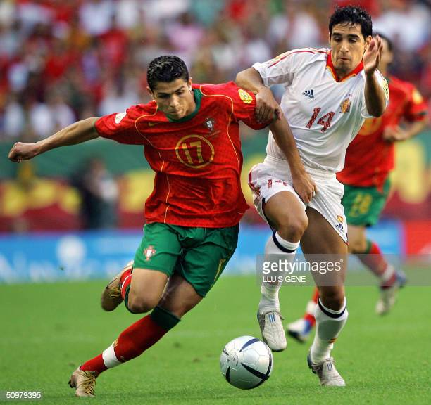 Portugal's forward Cristiano Ronaldo vies with Spain's midfielder Vicente, 20 June 2004 at Jose Alvalade Stadium in Lisbon, during their Euro 2004...