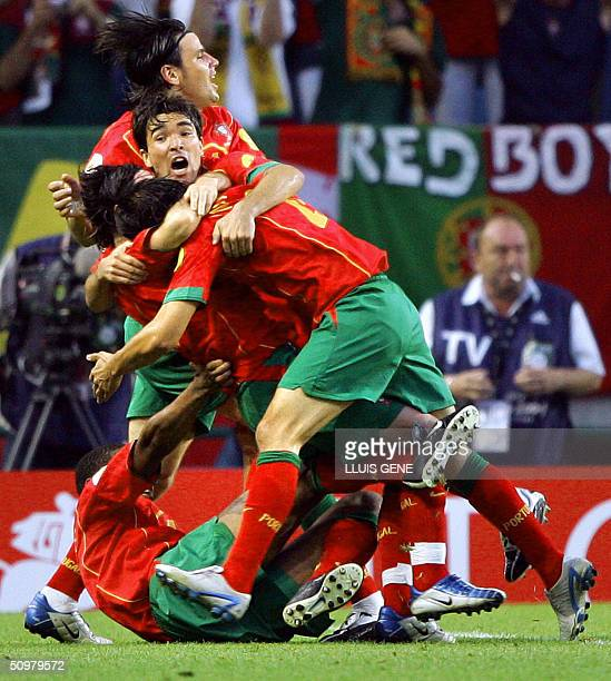 Portugal's forward Nuno Gomes is congratulated by his teammates after scoring the opening goal for his team, 20 June 2004 at Jose Alvalade Stadium in...