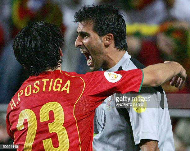 Portugal's goalkeeper Ricardo celebrates with his teammate forward Helder Postiga after scoring the winning penalty 24 June 2004 during their...