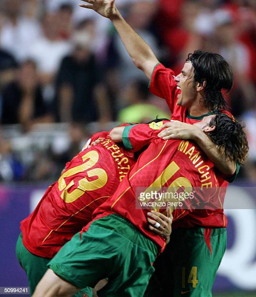 Portugal's players forward Helder Postiga midfielder Maniche and Nuno Valente celebrates after Portugal's goal during the prolongations 24 June 2004...